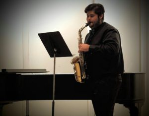 Student playing Alto Saxophone