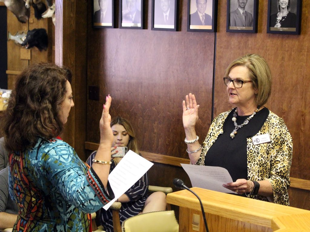 Image of Emma Krabill being sworn-in to Board of Trustees