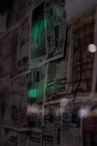 Newspapers seen through a rainy window